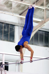 gymnast competing on high bar