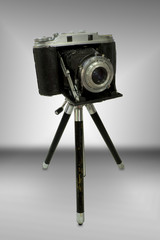 vintage rangefinder camera on tripod
