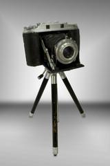 vintage rangefinder camera on tripod