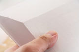 hand turning pages of a book poster