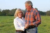 handsome farm couple poster
