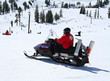 rescuer on snowmobile