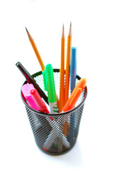 pens and pencils in pencil holder