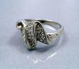 ring from white gold with brilliants poster