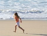 girl running on beach poster