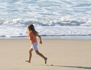 girl running on beach