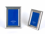 silver picture frames against white background poster