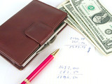 us dollars, notebook and pen poster