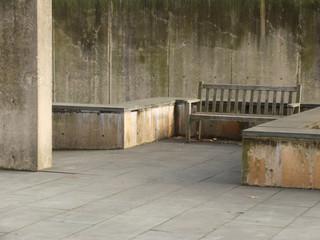 empty bench in concrete garden