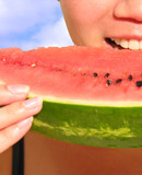 woman eating watermelon poster