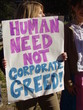 sign decries corporate greed at peace rally