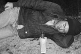 homeless man - sleeping on ground b&w poster