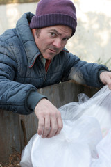 homeless man - digging in dumpster