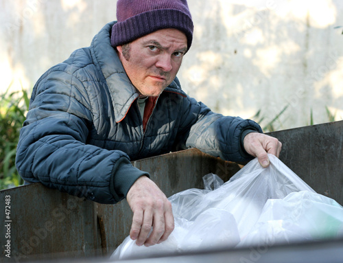 homeless man - roots in dumpster