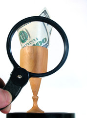 money under a magnifier