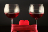 two wine glasses wrapped with tape and heart poster