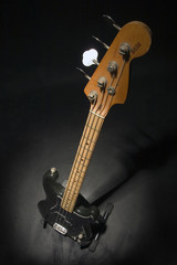 bass guitar in dark