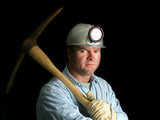 coal miner with pickax - in the dark poster