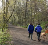 women walking dog on trail poster