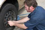mechanic removing lug nuts poster