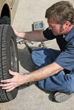mechanic removing tire poster