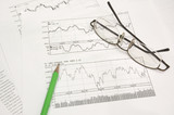 stock graphs, pencil and glasses poster
