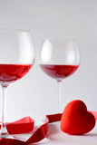 two wine glasses and a heart poster