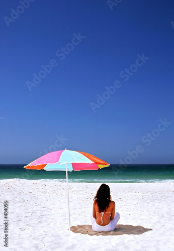 Woman Sitting Under a Beach Umbrella - Royalty Free Clip Art Image
