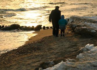 evening walk along  a line of a surf