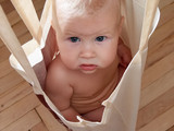 baby in bag poster