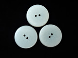three round white buttons poster