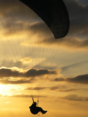 hang glider in sunset, close