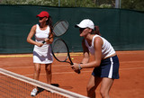 Fototapety two fit, young, healthy women playing doubles at tennis in the s