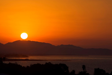 golden sunrise over port of marbella