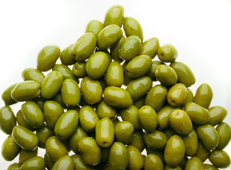 delicious group of shinny olives over a white back