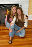 beautiful sisters by fireplace poster