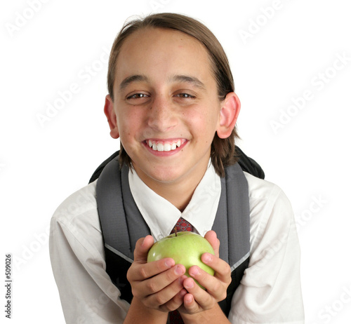adorable school boy with apple