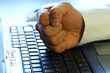 fist on laptop