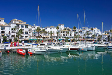 boats and yachts moored in duquesa port in spain on the costa de