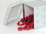 silver box red beads poster