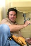 plumber working poster