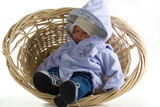 smiling wicker baby (this a toy doll) poster