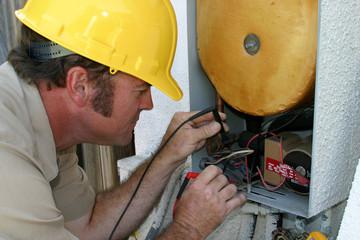 air conditioning repairman working