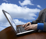 sky,businessman and laptop poster
