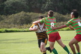 rugby player stopping an opponent poster