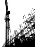 construction site with crane and scaffolding poster