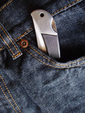 pocket knife in front pocket of blue jeans poster