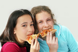 two girls eating pizza poster