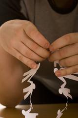 child`s hand do paper chain