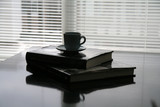 books lay on the table and coffee cup poster